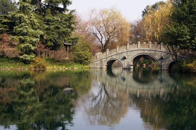 Chinese bridge over the lake in Hangzhou, China.